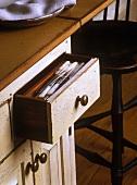 Open drawer in vintage kitchen cupboard