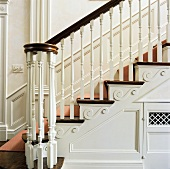 White, Georgian staircase with wooden treads and stair runner