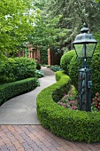 Curved garden patch with lantern