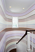 Stairwell with pattern of stripes on curved walls