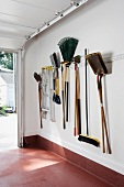 Gardening utensils hanging on garage wall