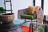 Contemporary armchair with green cushion and colorful throw pillow