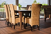 Outdoor dining table and wicker chairs