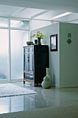 Armoire in modern home entry