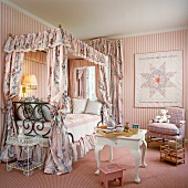 Pink girl's bedroom with canopied bed