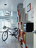Boy's room with cubic shelving, bike and spiral staircase