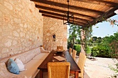 Outdoor dining area with stone walls
