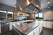 Contemporary kitchen with large vent hood