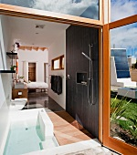 Master bathroom and bedroom in modern eco friendly home