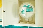 Shaving mirror in open cupboard