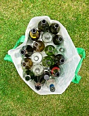 Close up of empty bottles in plastic bag