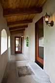 Vignette of hallway with wood door arches and lights.