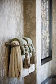 Handle towels on towel bar tied with tassels