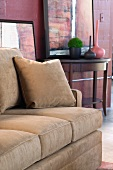 Detail tan sofa with throw pillow