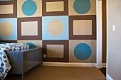 Geometric patterns on wall in bedroom