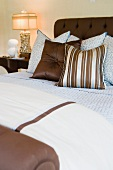 Blue and brown bedding on contemporary bed