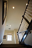 Recessed lights above staircase