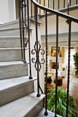 Detail wooden staircase with wrought iron railing