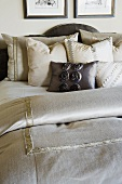 Collection of throw pillows on bed