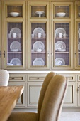 Selective focus china stored in contemporary china cabinet