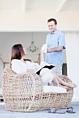 Man bringing girlfriend coffee on porch