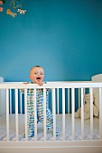 Toddler standing up in crib