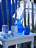 Blue and white crockery on a small wooden table