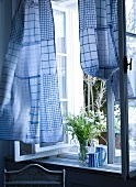 Curtain made of blue and white dish towels