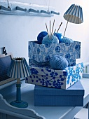Old shoe boxes covered with blue and white fabric as organizers