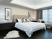 Elegant bedroom with animal skin rug