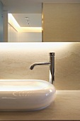 Detail of modern bathroom sink and faucet