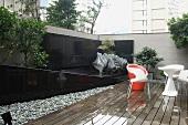 Modern deck furniture in rain on wooden deck