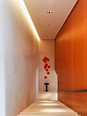 Modern staircase with orange accents