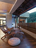Wooden lounge chairs on hardwood deck