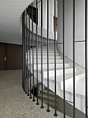 Contemporary winding staircase surrounded by bars