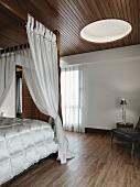 Modern bedroom with hardwood floors