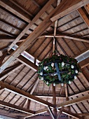 Detail wooden beamed ceiling with old fashioned lighting fixture