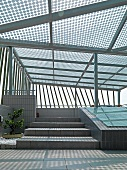 Rooftop deck covered with glass canopy