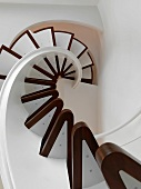 View from bottom up modern spiral staircase