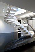 Modern white staircase with glass banister