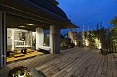 Oriental dining room open to outdoor deck