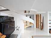 Modern winding staircase and television
