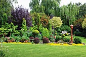 Large variety of plants in elegant gardens with artistically clipped shrubs and manicured lawn