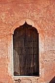 Ornate window in sand wall