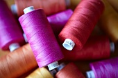 Close up of colorful spools of thread