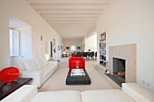 Modern white living room with red chair