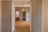 Doorway between two empty rooms with stone floors