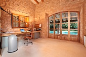Home office with stone walls