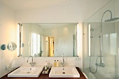 His and her sinks in clean modern bathroom