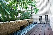 Stools on small patio along house